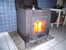 The woodburner in our kitchen keeps us warm and we cook on it.